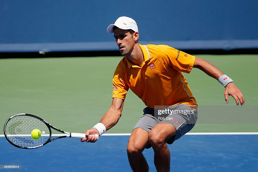 Novak Djokovic of Serbia returns a shot to David Goffin of Belgium during the Western & Southern Open at the Linder Family Tennis Center on August 20, 2015 in Cincinnati, Ohio.