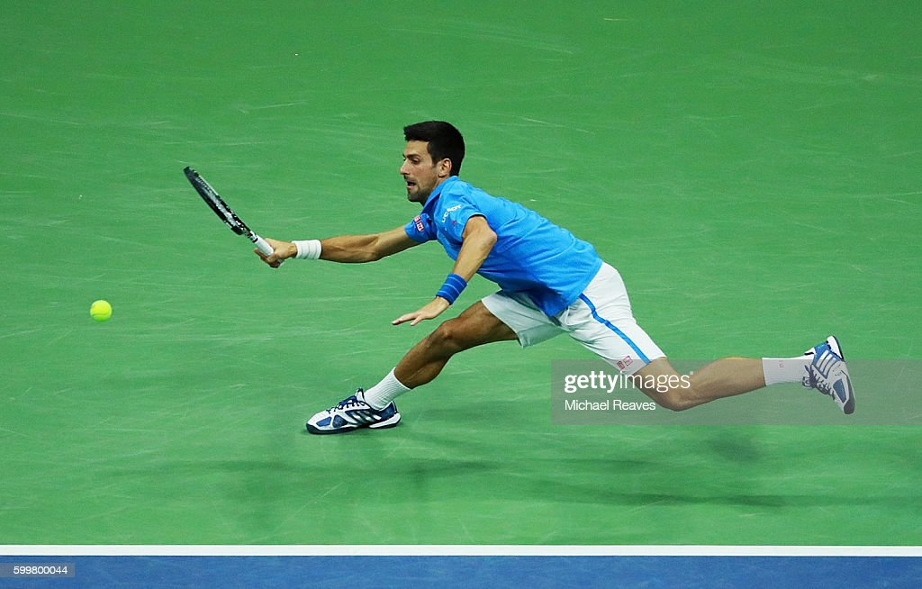 Novak Djokovic of Serbia returns a shot to Jo-Wilfried Tsonga of France during their Men's Singles Quarterfinals match on Day Nine of the 2016 US Open at the USTA Billie Jean King National Tennis Center on September 6, 2016 in the Flushing neighborhood of the Queens borough of New York City.