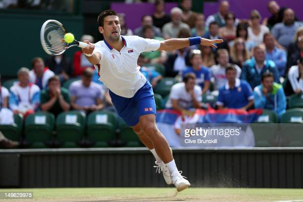 Novak Djokovic of Serbia returns a shot to Lleyton Hewitt of Australia during the third round of Men's Singles Tennis on Day 5 of the London 2012...