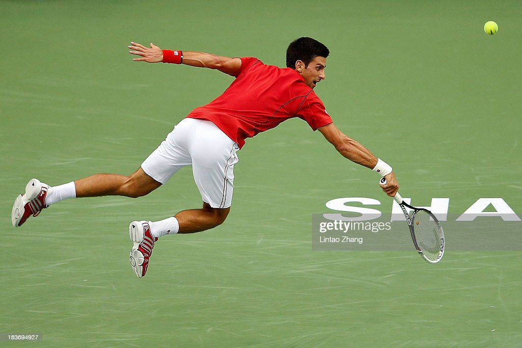 Novak Djokovic of Serbia returns a shot to Marcel Granollers of Spain during day three of the Shanghai Rolex Masters at the Qi Zhong Tennis Center on October 9, 2013 in Shanghai, China.