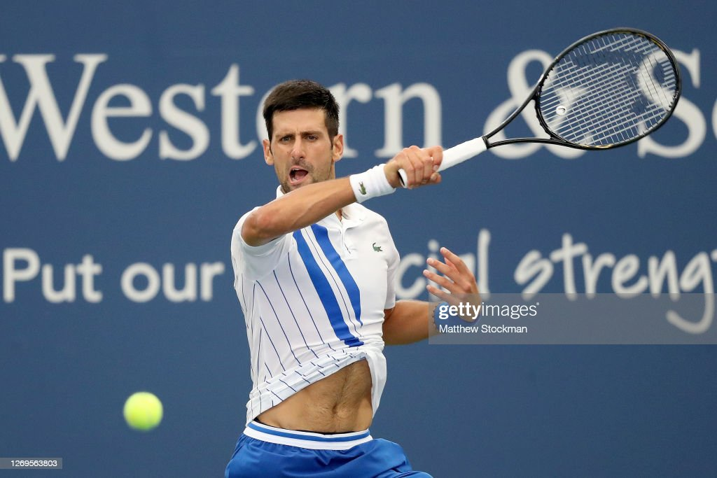 Novak Djokovic Of Serbia Returns A Shot To Milos Raonic Of Canada In News Photo Getty Images