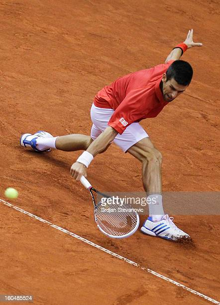 Novak Djokovic of Serbia returns a shot to Olivier Rochus of Belgium during the Davis Cup singles first round match between Belgium and Serbia at...