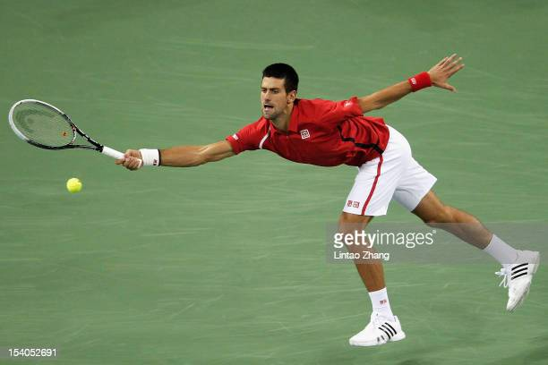 Novak Djokovic of Serbia returns a shot to Tomas Berdych of Czech Republic during the Men's Single Semifinal of the Shanghai Rolex Masters at the Qi...