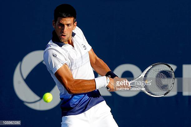 Novak Djokovic of Serbia returns a shot to Victor Hanescu of Romania during the Rogers Cup at the Rexall Centre on August 12 2010 in Toronto Canada