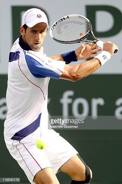 Novak Djokovic of Serbia returns a shot to Viktor Troicki of Serbia during the BNP Paribas Open at the Indian Wells Tennis Garden on March 16, 2011...