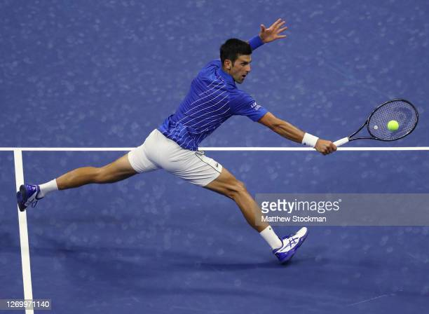 Novak Djokovic of Serbia returns a volley during his Men's Singles first round match against Damir Dzumhur of Bosnia and Herzegovina on Day One of...
