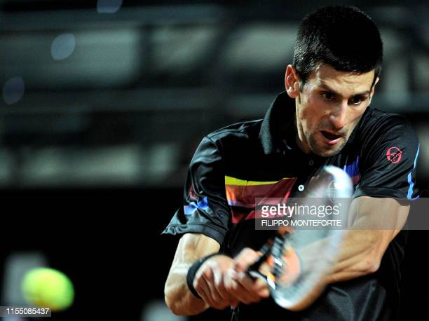 Novak Djokovic of Serbia returns against Andy Murray of Britain during their ATP Rome Open tennis tournament semifinal match in Rome's Foro Italico...