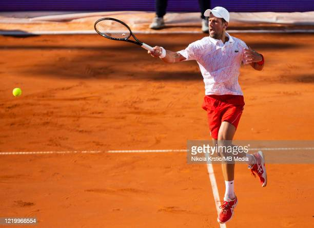 Novak Djokovic of Serbia returns during his match against Alexander Zverev of Germany on June 14 during the 3rd day of Summer Adria Tour 2020 in...