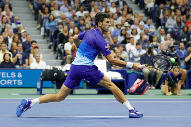 Novak Djokovic of Serbia returns the ball against Alexander Zverev of Germany during their Men's Singles semifinal match on Day Twelve of the 2021 US...
