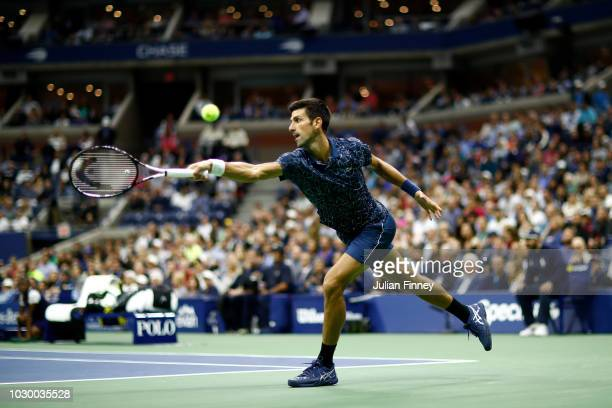 Novak Djokovic of Serbia returns the ball during his men's Singles finals match against Juan Martin del Potro of Argentina on Day Fourteen of the...