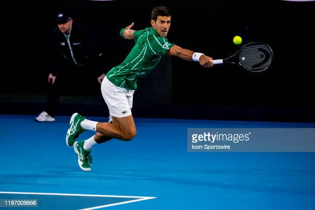 Novak Djokovic of Serbia returns the ball during the quarterfinals of the 2020 Australian Open on January 28 2020 at Melbourne Park in Melbourne...