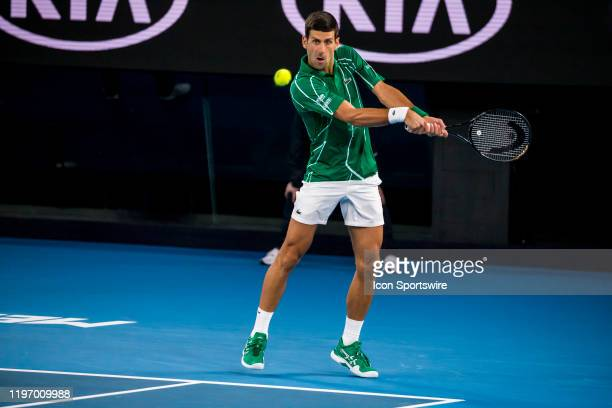 Novak Djokovic of Serbia returns the ball during the quarterfinals of the 2020 Australian Open on January 28 2020, at Melbourne Park in Melbourne,...