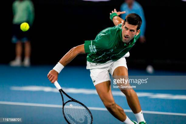 Novak Djokovic of Serbia returns the ball during the semifinals of the 2020 Australian Open on January 30 2020 at Melbourne Park in Melbourne...