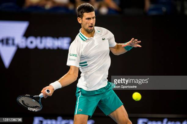 Novak Djokovic of Serbia returns the ball during the semifinals of the 2021 Australian Open on February 18 2021, at Melbourne Park in Melbourne,...