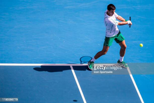 Novak Djokovic of Serbia returns the ball during the third round of the 2020 Australian Open on January 24 2020, at Melbourne Park in Melbourne,...