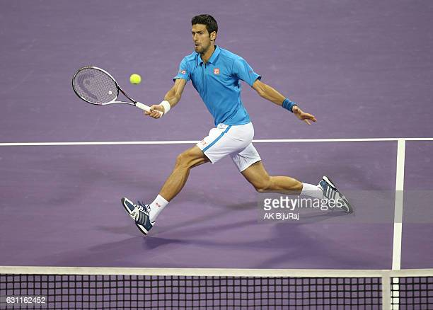 Novak Djokovic of Serbia returns the ball to Andy Murray of Great Britain during the men's singles final match of the ATP Qatar Open tennis...