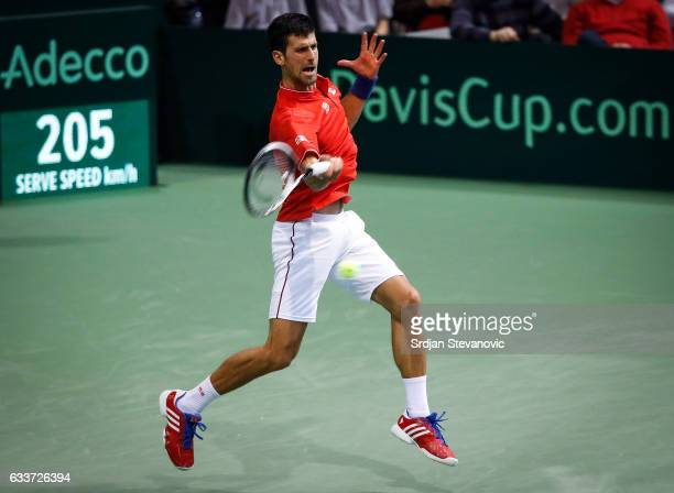 Novak Djokovic of Serbia returns the ball to Daniil Medvedev of Russia during the Davis Cup World Group first round single match between Serbia and...