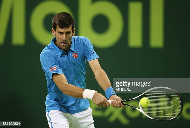 Novak Djokovic of Serbia returns the ball to Fernando Verdasco of Spain during the semifinal match of the ATP Qatar Open tennis competition held at...