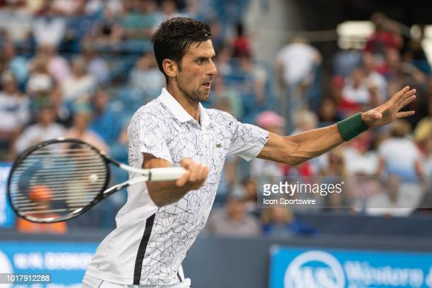 Novak Djokovic of Serbia returns the ball to Grigor Dimitrov of Bulgaria during Day 5 of the Western and Southern Open at the Lindner Family Tennis...
