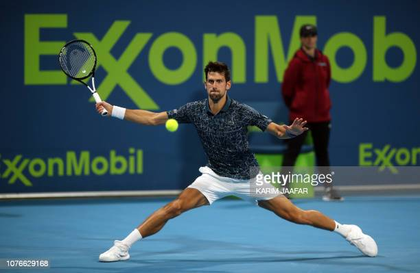Novak Djokovic of Serbia returns the ball to Nikoloz Basilashvili of Georgia during their ATP Qatar Open tennis quarterfinal in Doha on January 3 2019