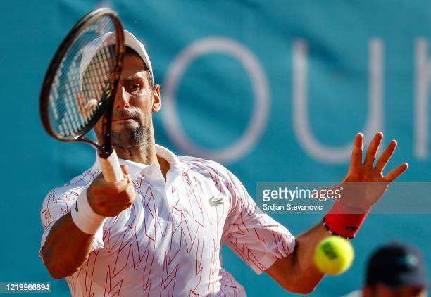 Novak Djokovic of Serbia returns the to Alexander Zverev of Germany during the Adria Tour charity exhibition tournament hosted by Novak Djokovic on...