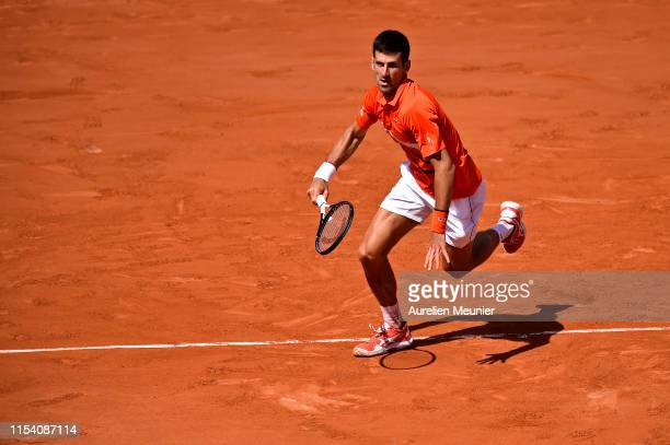 Novak Djokovic of Serbia runs for the ball during his mens singles quarterfinal match against Alexander Zverev of Germany during Day twelve of the...