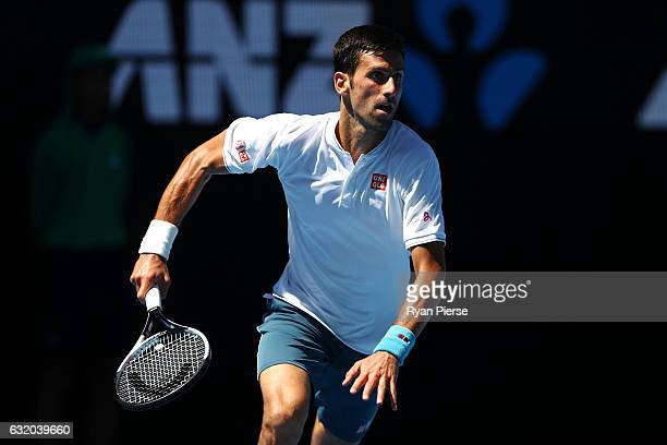 Novak Djokovic of Serbia runs to play a shot in his second round match against Denis Istomin of Uzbekistan on day four of the 2017 Australian Open at...