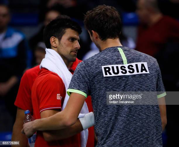 Novak Djokovic of Serbia salutes Daniil Medvedev of Russia after winning the Davis Cup World Group first round single match between Serbia and Russia...
