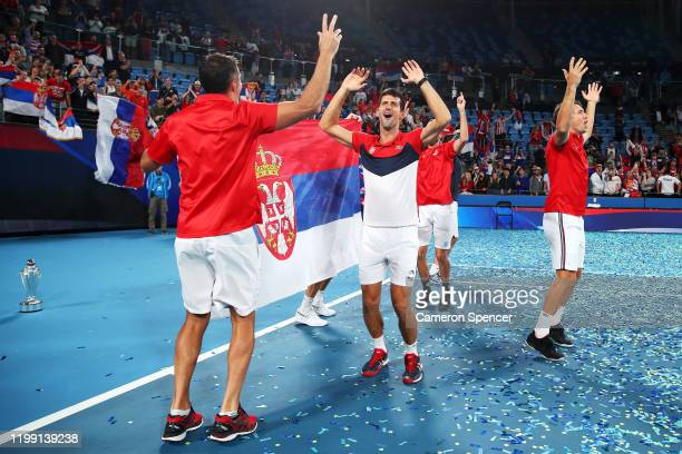 Novak Djokovic of Serbia Serbia captain Nenad Zimonjic and team mates celebrate on court after winning the ATP Cup final against Spain during day 10...