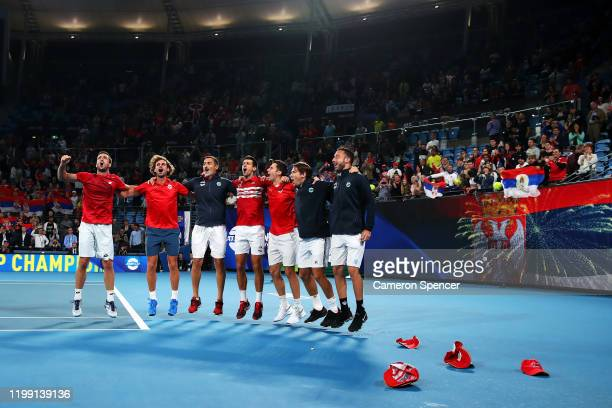 Novak Djokovic of Serbia Serbia captain Nenad Zimonjic celebrate on court after winning the ATP Cup final against Spain during day 10 of the ATP Cup...