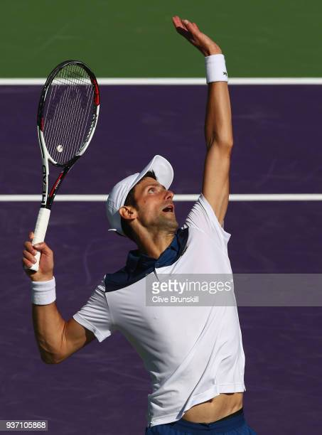 Novak Djokovic of Serbia serves against Benoit Paire of France in their second round match during the Miami Open Presented by Itau at Crandon Park...
