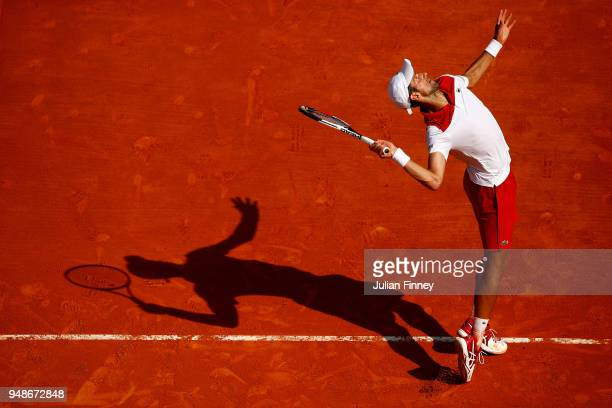 Novak Djokovic of Serbia serves against Dominic Thiem of Austria during his men's singles 3rd round match on day five of the Rolex MonteCarlo Masters...