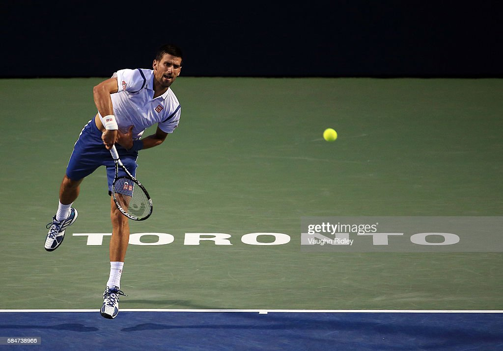 Novak Djokovic of Serbia serves against Gael Monfils of France during Day 6 of the Rogers Cup at the Aviva Centre on July 30, 2016 in Toronto, Ontario, Canada.
