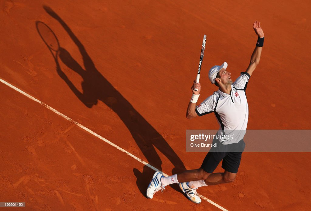 Novak Djokovic of Serbia serves against Juan Monaco of Argentina in their third round match during day five of the ATP Monte Carlo Masters,at Monte-Carlo Sporting Club on April 18, 2013 in Monte-Carlo, Monaco.