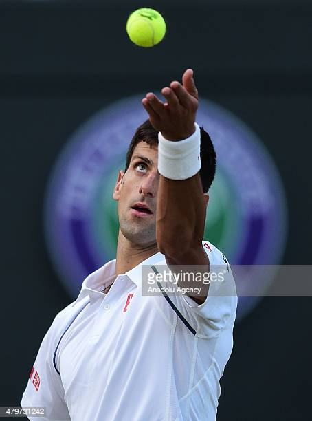 Novak Djokovic of Serbia serves against Kevin Anderson of South Africa during day eight of the Wimbledon Lawn Tennis Championships at the All England...