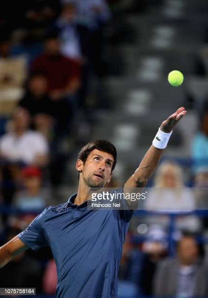 Novak Djokovic of Serbia serves against Kevin Anderson of South Africa during the men's final match of the Mubadala World Tennis Championship at...