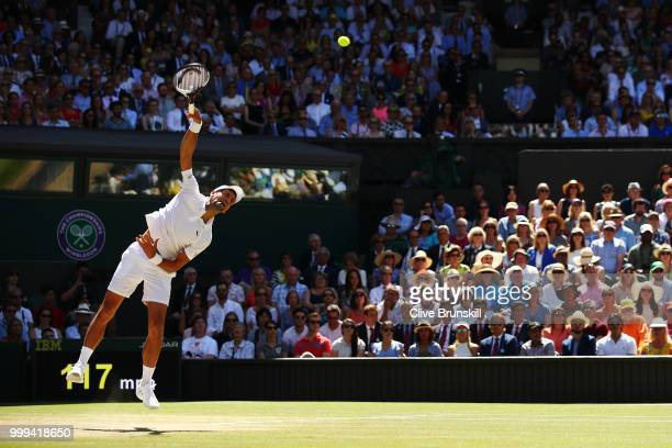 Novak Djokovic of Serbia serves against Kevin Anderson of South Africa during the Men's Singles final on day thirteen of the Wimbledon Lawn Tennis...