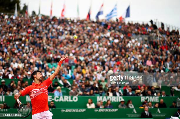Novak Djokovic of Serbia serves against Philipp Kohlschreiber of Germany in their second round match during day 3 of the Rolex Monte-Carlo Masters at...