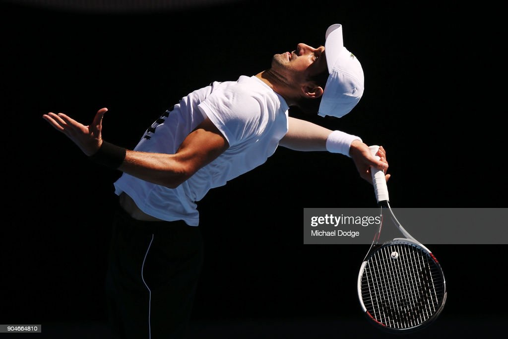 Novak Djokovic of Serbia serves during a practice session ahead of the 2018 Australian Open at Melbourne Park on January 14, 2018 in Melbourne, Australia.