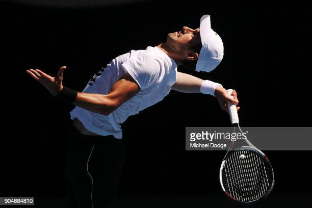 Novak Djokovic of Serbia serves during a practice session ahead of the 2018 Australian Open at Melbourne Park on January 14 2018 in Melbourne...