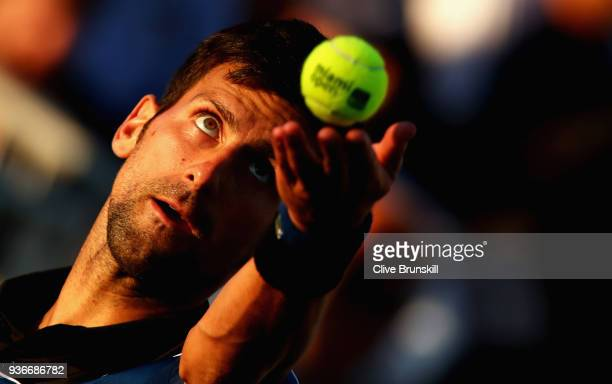 Novak Djokovic of Serbia serves during his first round doubles match during the Miami Open Presented by Itau at Crandon Park Tennis Center on March...