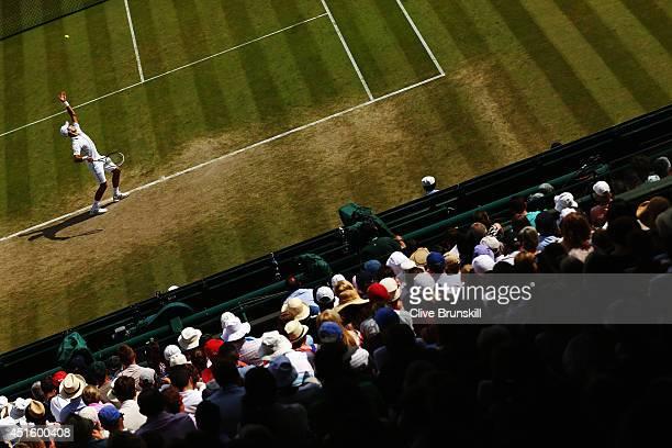 Novak Djokovic of Serbia serves during his Gentlemen's Singles quarterfinal match against Marin Cilic of Croatia on day nine of the Wimbledon Lawn...