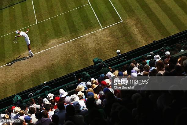 Novak Djokovic of Serbia serves during his Gentlemen's Singles quarterfinal match against Marin Cilic of Croatia on day nine of the Wimbledon Lawn...