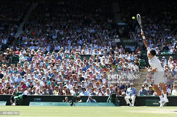 Novak Djokovic of Serbia serves during his Gentlemen's Singles semifinal match against Grigor Dimitrov of Bulgaria on day eleven of the Wimbledon...