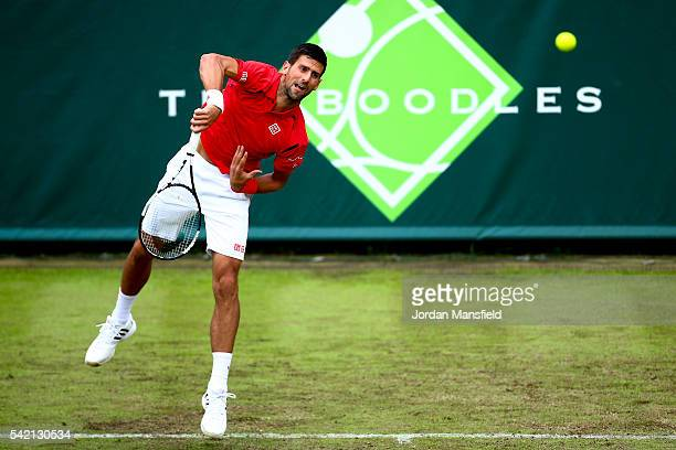 Novak Djokovic of Serbia serves during his match against David Goffin of Belgium during day two of The Boodles Tennis Event at Stoke Park on June 22,...