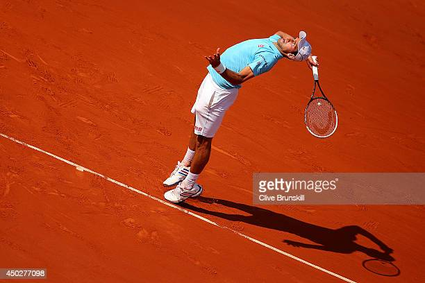 Novak Djokovic of Serbia serves during his men's singles final match against Rafael Nadal of Spain on day fifteen of the French Open at Roland Garros...
