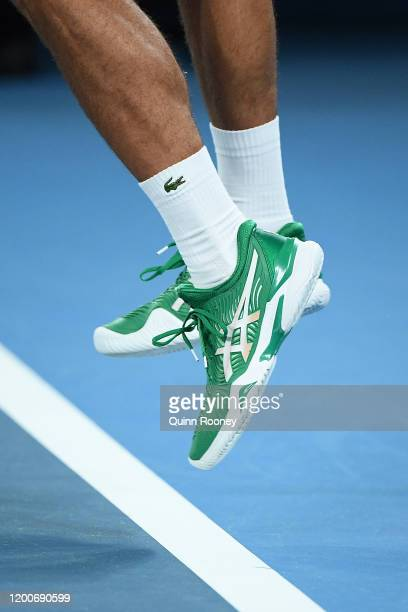 Novak Djokovic of Serbia serves during his Men's Singles first round match against Jan-Lennard Struff of Germany on day one of the 2020 Australian...