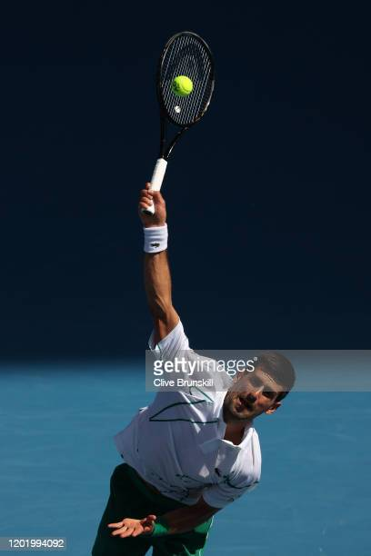 Novak Djokovic of Serbia serves during his Men's Singles fourth round match against Diego Schwartzman of Argentina on day seven of the 2020...