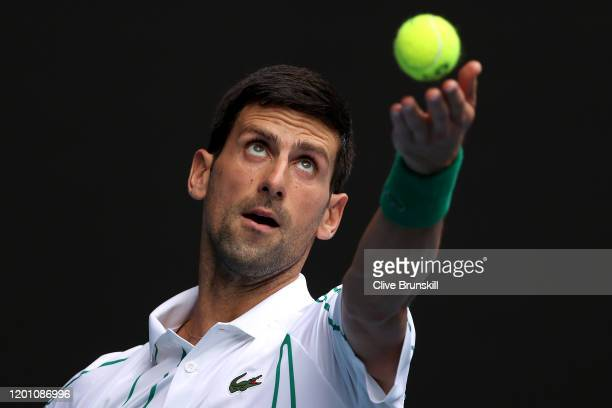 Novak Djokovic of Serbia serves during his Men's Singles second round match against Tatsuma Ito of Japan on day three of the 2020 Australian Open at...