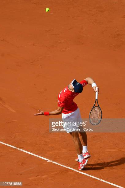 Novak Djokovic of Serbia serves during his Men's Singles second round match against Ricardas Berankis of Lithuania on day five of the 2020 French...